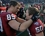 (Cambridge Ma 11/22/14) Harvard 50, Connor Sheehan, gets a hug from Harvard 89, Jameson McShea,  after the big interception in the second half, as Harvard defeated Yale 31-24. Jim Michaud Photo
