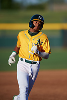 AZL Athletics Gold Marcus Smith (5) jogs toward third base during an Arizona League game against the AZL Rangers on July 15, 2019 at Hohokam Stadium in Mesa, Arizona. The AZL Athletics Gold defeated the AZL Athletics Gold 9-8 in 11 innings. (Zachary Lucy/Four Seam Images)