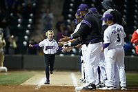 "Mackenzie Boyles runs down the first base line slapping hands with the Winston-Salem Dash players as she takes her ""Home Run for Life"" trot during the game against the Frederick Keys at BB&T Ballpark on April 26, 2019 in Winston-Salem, North Carolina. The Keys defeated the Warthogs 7-0. (Brian Westerholt/Four Seam Images)"