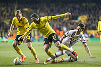 Son Heung-Min of Tottenham Hotspur (right) is dispossesed by Gonzalo Castro of Borussia Dortmund (27) while Marcel Schmelzer of Borussia Dortmund (left) looks on during the UEFA Europa League match between Tottenham Hotspur and Borussia Dortmund at White Hart Lane, London, England on 17 March 2016. Photo by David Horn / PRiME Media Images