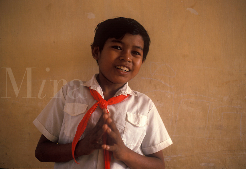 Young Cambodian orphan in school uniform