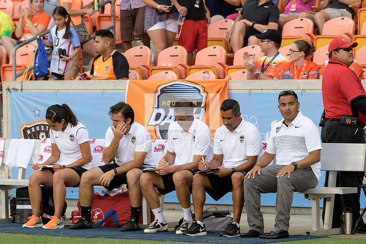 Houston, TX - Saturday June 17, 2017: The Houston Dash coaching staff during a regular season National Women's Soccer League (NWSL) match between the Houston Dash and the Orlando Pride at BBVA Compass Stadium.
