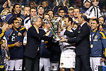 20 November 2011: Major League Soccer commissioner Don Garber (right) hands the Philip F. Anschutz trophy to Galaxy owner Philip F. Anschutz (left) and Los Angeles' Landon Donovan (10). The Los Angeles Galaxy defeated the Houston Dynamo 1-0 at the Home Depot Center in Carson, CA in MLS Cup 2011, Major League Soccer's championship game.