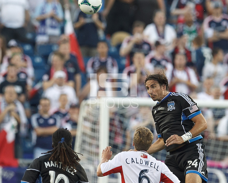 San Jose Earthquakes forward Alan Gordon (24) heads the ball.  In a Major League Soccer (MLS) match, the New England Revolution (white) defeated San Jose Earthquakes (black), 2-0, at Gillette Stadium on July 6, 2013.