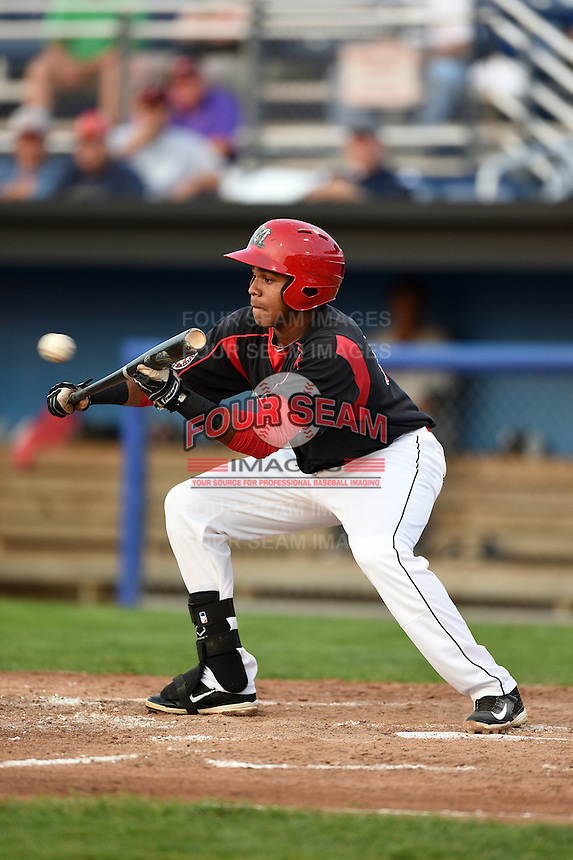 Batavia Muckdogs outfielder Wildert Pujols (38) squares to bunt during a game against the Staten Island Yankees on August 6, 2014 at Dwyer Stadium in Batavia, New York.  Batavia defeated Staten Island 5-3.  (Mike Janes/Four Seam Images)