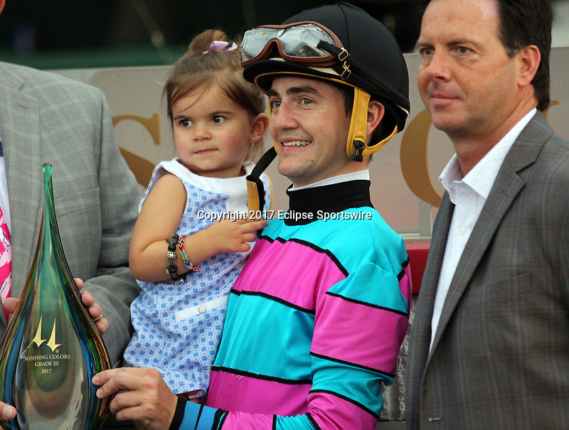 LOUISVILLE, KY - MAY 27: Jockey Brian J. Hernandez Jr., his daughter Joshlyn, and trainer W. Bret Calhoun accept the trophy for winning the G3 Winning Colors Stakes with Finley'sluckycharm, Churchill Downs, Louisville, Kentucky. (Photo by Mary M. Meek/Eclipse Sportswire/Getty Images)