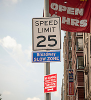 "A sign on Broadway in New York  proclaims the new ""Broadway Slow Zone"" on Monday, August 4, 2014. As part of Mayor Bill de Blasio's ""Vision Zero"" initiative the speed limit of 30 mph has been reduced to 25 mph. Broadway from West 59th Street to West 220 Street has been posted as a ""Slow Zone"". with the other ""Slow Zone"" starting today atSouthern Blvd. in the Bronx. Two dozen zones will be instituted in the five boroughs over the course of several months. 22 pedestrians have been killed since 2008 in the ""Broadway Slow Zone"" and speeding is the top cause of traffic injuries and fatalities.   (© Richard B. Levine)"