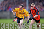 Derek Galvin(13) of Listowel Emmets races against Tarberts Danny Wren(5) in the North Kerry Senior Football Final held last Sunday in Bob Stack Park, Ballybunion..