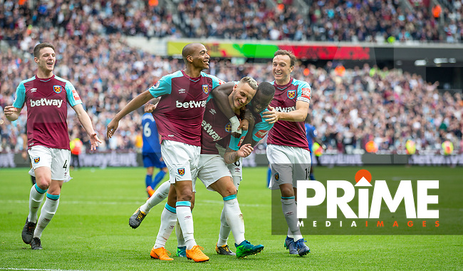 Teammates celebrate with goal scorer Marko Arnautovic of West Ham during the Premier League match between West Ham United and Everton at the Olympic Park, London, England on 13 May 2018. Photo by Andy Rowland / PRiME Media Images.