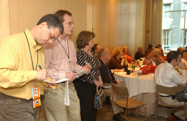 8/29/04.2004 REPUBLICAN NATIONAL CONVENTION/REGIONAL REPORTERS--Kane Webb, columnist and editorial writer, and reporter Andrew DeMillo, both with the Arkansas Democrat-Gazette, cover the Arkansas delegation breakfast at the W Hotel in New York..CONGRESSIONAL QUARTERLY PHOTO BY SCOTT J. FERRELL