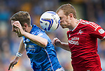St Johnstone v Aberdeen...23.08.14  SPFL<br /> Mark Reynolds takes a sore one on the nose as he clears from Steven MacLean<br /> Picture by Graeme Hart.<br /> Copyright Perthshire Picture Agency<br /> Tel: 01738 623350  Mobile: 07990 594431