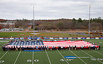EASTON, MA - NOVEMBER 20:  Teams and veterans hold the flag before the game between Shippensburg University and LIU Post in the NCAA Division II Field Hockey Championship at WB Mason Stadium on November 20, 2016 in Easton, Massachusetts.  Shippensburg University defeated LIU Post 2-1 for the national title. (Photo by Winslow Townson/NCAA Photos via Getty Images)