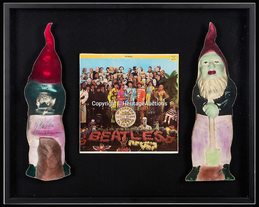BNPS.co.uk (01202 558833)<br /> Pic: HeritageAuctions/BNPS<br /> <br /> *Please use full byline*<br /> <br /> The gnome. front and back, with the album.<br /> <br /> This humble garden gnome might not look anything special but it has just gone on sale with a whopping &pound;17,000 price tag - because it starred on the iconic cover of The Beatles' Sgt Pepper's album.<br /> <br /> The cardboard gnome featured alongside a host of celebrities and historic figures including actress Diana Dors, singer Bob Dylan and actor Marlon Brando on the psychedelic cover of the ground-breaking 1967 album.<br />  <br /> Following the photoshoot photographer Michael Cooper's assistant was given the 20-inch tall cardboard gnome as a souvenir by The Beatles, who each signed it.<br /> <br /> Experts at Heritage Auctions in Dallas, Texas, have given the gnome a pre-sale estimate of $25,000 - around &pound;17,000 - but say that given the enduring interest in The Beatles it could sell for much more.