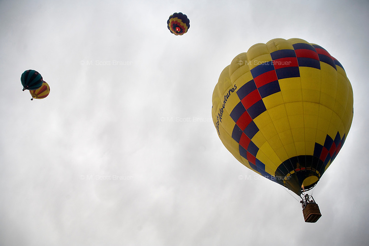 Hot air balloons lift off into the sky for the Great Prosser Balloon Rally in Prosser, Washington, USA.