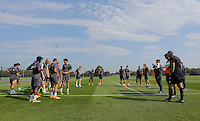 Pictured: Players and coaching staff gather on the pitch Wednesday 14 September 2016<br />Re: Swansea City FC training at Fairwood, Wales, UK