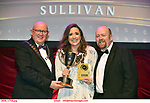 16-6-2019:  Nenagh Choral Society-Raise Your Voice-Sister Act Stephanie Browne, Tipperary winner of the Best Ensemble award at the annual AIMS (Association of Irish Musical Societies) in the INEC Killarney at the weekend receiving the trophy from Seamus Power, President, AIMS left and Rob Donnelly, Vice-President.<br /> Photo: Don MacMonagle - macmonagle.com<br /> <br /> repro free photo from AIMS<br /> <br /> AIMS PRESS RELEASE: There was plenty of glitz and glamour in Killarney on Saturday night as The Association of Irish Musical Societies has its Annual Awards Ceremony in Killarney. Over 1,500 people could be heard over the Kerry mountains as the winners were announced by MC Fergal D'Arcy. Many societies were double winners on the night including UCD Musical Society, Dublin were dancing all the way to the trophies winning Best Choreography and Best Choreographer for Leah Meagher for Cabaret and  Tullamore Musical Society who took their moment as Chris Corroon won Best Male Singer for his sinful performance as Henry Jekyll in Jekyll &Hyde and also Director Paul Norton who'd plenty to celebrate picking Best Director for  the same show. The moment was once again taken by Jekyll&Hyde by Dùn Laoighaire Musical&Dramatic Society as Kevin Hartnett took up Best Male Singer in the Sullivan category.Nenagh Youth Musical Society raised their voices high and took home Best Ensemble. It was a superior night for Enniscorthy Musical Society by winning Best Comedienne for Jennifer Byrne as Mother Superior and Best Technical too. Portlaoise Musical Society rose to the top by taking home Best Overall Show in the Gilbert section for their stunning production of Titanic. Oyster Lane Theatre Group, Wexford flew their flag high taking home Best Overall Show in the Sullivan Section for their breathtaking production of Michael Collins-a Musical Drama.<br /> Other winners on the night included Best Comedian for Ronan Walsh as Officer Lockstock in Urinetown for Trim Musical Society, Best Actress in a Supporting Role fo