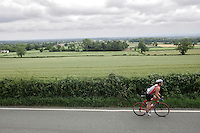 25 JUN 2006 - CHESTER, UK - No time to look - a lone competitor has no time to admire the countryside during the Royles Deva Triathlon. (PHOTO (C) NIGEL FARROW)