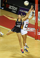 28.07.2015 Silver Ferns Casey Kopua and South Africa's Lenize Potgieter in action during the Silver Fern v South Africa netball test match played at Trusts Arena in Auckland. Mandatory Photo Credit ©Michael Bradley.