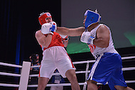 Fairfax, VA - July 1, 2015: Abdussanat Sharafov (red) of the Kazakhstan Fire Department dodges the punch of Berinder Singh (Blue) of the Indian Police Service in a boxing match during the World Police and Fire Games at the George Mason University in Fairfax, VA, July 1, 2015.   (Photo by Don Baxter/Media Images International)