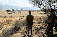 KENYA, Marsabit, airstrip of Lake Turkana Wind Power Project, Vestas will supply in the next four years wind turbines and rotor blades for the 310 MW project, the largest windfarm in africa, security guards with gun / KENIA, Marsabit, Landepiste des Lake Turkana Wind Power Projekt, hier werden in den naechsten 4 Jahren Wind Turbinen und Rotorblaetter des Herstellers Vestas fuer das 310 MW Projekt aufgebaut