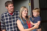 NWA Democrat-Gazette/FLIP PUTTHOFF <br />Garrett and Amanda Gittlein, with their son, Colson, 3, listen to remarks Tuesday June 13 at their farm near Maysville. The Gittleins are Benton County Farm Family of the Year for 2017.