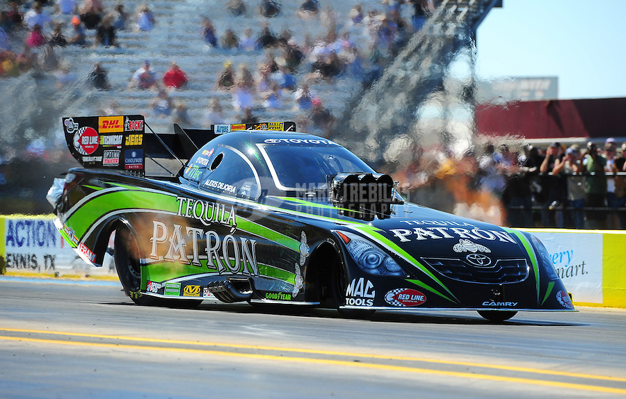 Sept. 18, 2011; Ennis, TX, USA: NHRA funny car driver Alexis DeJoria during qualifying for the Fall Nationals at the Texas Motorplex. Mandatory Credit: Mark J. Rebilas-