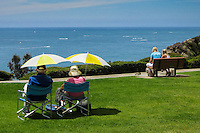 Couples Sitting and Enjoying the Scenic Ocean View in Dana Point