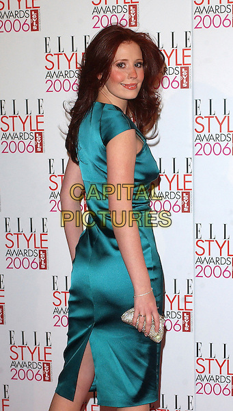 AMY NUTTALL.The Elle Style Awards 2006, Atlantis Gallery, Old Truman Brewery, Brick Lane, London, UK..February 20th, 2006 .Ref: BEL.half length blue dress green looking over shoulder.www.capitalpictures.com.sales@capitalpictures.com.© Capital Pictures.
