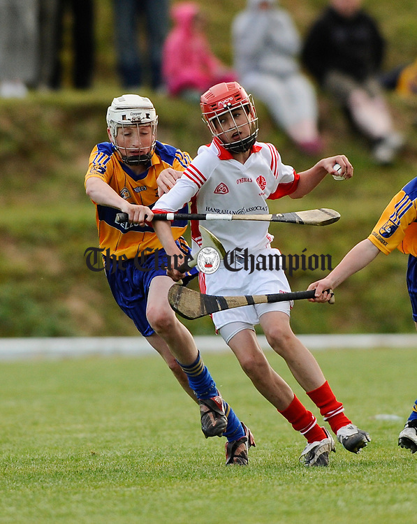 Eire Og's Lee Quirke in action against Sixmilebridge's Kevin Fennessy during their U-14 A final at Tulla. Photograph by John Kelly.