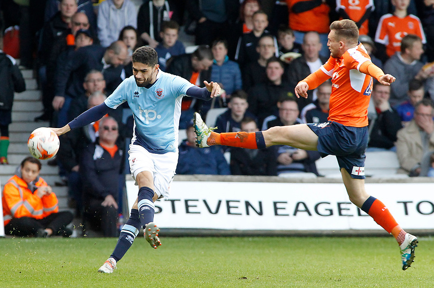 Blackpool's Kelvin Mellor clears the danger away Luton Town's Lawson D'Ath<br /> <br /> Photographer David Shipman/CameraSport<br /> <br /> The EFL Sky Bet League Two - Luton Town v Blackpool - Saturday 1st April 2017 - Kenilworth Road - Luton<br /> <br /> World Copyright &copy; 2017 CameraSport. All rights reserved. 43 Linden Ave. Countesthorpe. Leicester. England. LE8 5PG - Tel: +44 (0) 116 277 4147 - admin@camerasport.com - www.camerasport.com