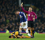 James McCarthy of Everton receives a yellow card for his tackle of Francis Coquelin of Arsenal (ground) during the English Premier League match at Goodison Park Stadium, Liverpool. Picture date: December 13th, 2016. Pic Simon Bellis/Sportimage