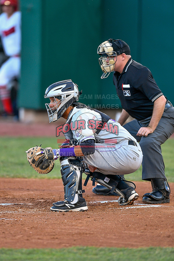 Joel Diaz (5) of the Grand Junction Rockies on defense against the Orem Owlz in Pioneer League action at Home of the Owlz on July 6, 2016 in Orem, Utah. Home plate umpire Jake Botek handles the calls. The Rockies defeated the Owlz 5-4 in Game 2 of the double header.  (Stephen Smith/Four Seam Images)