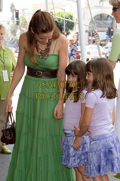 "KELLY PRESTON & DAUGHTERS (ELLA BLEU TRAVOLTA).Walt Disney Pictures' World Premiere of ""Sky High"" held at the El Capitan Theatre, Hollywood, California..July 24th, 2005  .Photo Credit: Zach Lipp/AdMedia.half length holding hands mother family green dress brown belt matching blue skirts.www.capitalpictures.com.sales@capitalpictures.com.© Capital Pictures."