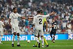 Real Madrid's Raphael Varane (l) and Dani Carvajal (r) have words with referee Santiago Jaime Latre during La Liga match. September 01, 2018. (ALTERPHOTOS/A. Perez Meca)