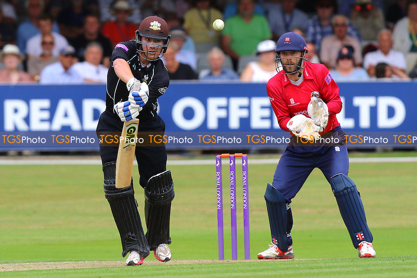 Rory Burns in batting action for Surrey as James Foster looks on from behind the stumps during Essex Eagles vs Surrey, Royal London One-Day Cup Cricket at the Essex County Ground on 24th July 2016
