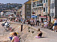 Holidaymakers walking along the harbour front in St Ives Cornwall..©shoutpictures.com..john@shoutpictures.com