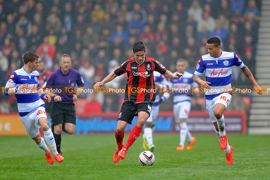 Andrew Surman of AFC Bournemouth takes on Jermaine Jenas of Queens Park Rangers - AFC Bournemouth vs Queens Park Rangers QPR - Sky Bet Championship Football at the Goldsands Stadium, Bournemouth, Dorset - 05/04/14 - MANDATORY CREDIT: Denis Murphy/TGSPHOTO - Self billing applies where appropriate - 0845 094 6026 - contact@tgsphoto.co.uk - NO UNPAID USE
