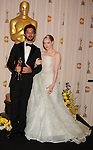 HOLLYWOOD, CA. - March 07: Musician Ryan Bingham and actress Amanda Seyfried pose in the press room at the 82nd Annual Academy Awards held at the Kodak Theatre on March 7, 2010 in Hollywood, California.
