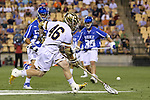 29 April 2016: Notre Dame's John Sexton (46) picks up a loose ball. The University of Notre Dame Fighting Irish played the Duke University Blue Devils at Fifth Third Bank Stadium in Kennesaw, Georgia in a 2016 Atlantic Coast Conference Men's Lacrosse Tournament semifinal match. Duke won the game 10-9 in overtime.