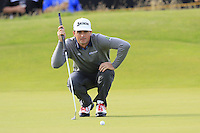 Keegan Bradley (USA) lines up his putt on the 14th green during Thursday's Round 1 of the 145th Open Championship held at Royal Troon Golf Club, Troon, Ayreshire, Scotland. 14th July 2016.<br /> Picture: Eoin Clarke | Golffile<br /> <br /> <br /> All photos usage must carry mandatory copyright credit (&copy; Golffile | Eoin Clarke)