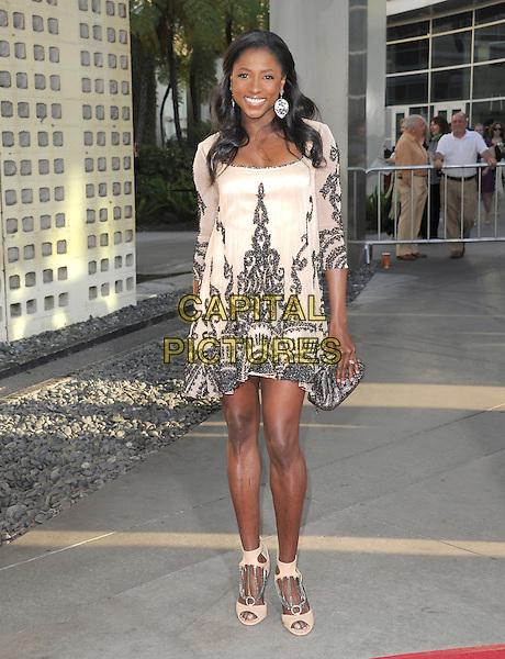 Rutina Wesley.The HBO Premiere of the 4th Season of True Blood held at The Arclight Cinerama Dome in Hollywood, California, USA..June 21st, 2011.full length dress white cream nude silk satin top earrings silver smiling  clutch bag shoes.CAP/RKE/DVS.©DVS/RockinExposures/Capital Pictures.