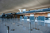 The morning hours are quiet at Air France and Korean Air, at the international terminal at Dulles International Airport in Dulles, Va., Monday, March16, 2020. Some people are taking the precaution of wearing face masks as they arrive to be greeted by family and or friends. Credit: Rod Lamkey / CNP