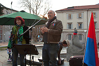 "Switzerland. Canton Ticino. Bellinzona. Political meeting of the Green Party "" I Verdi del Ticino"" on Piazza del Governo. Tamara Merlo (L) and Sergio Savoia (R) speak with a microphone to the party supporters. Ticino flags. The Green Party of Switzerland also called: German: Grüne Partei der Schweiz; French: Les verts – Parti écologiste suisse; Italian: I Verdi – Partito ecologista svizzero; Romansh: La Verda – Partida ecologica svizra; ""The Greens – Swiss ecological party"". 28.03.2015 © 2015 Didier Ruef"