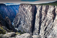 "The Black Canyon of The Gunnison cuts a rugged swath 48 miles long and over two thousand feet deep in places through western Colorado. Here, the famed ""Painted Wall"" rises 2,250 feet above the Gunnison River below."