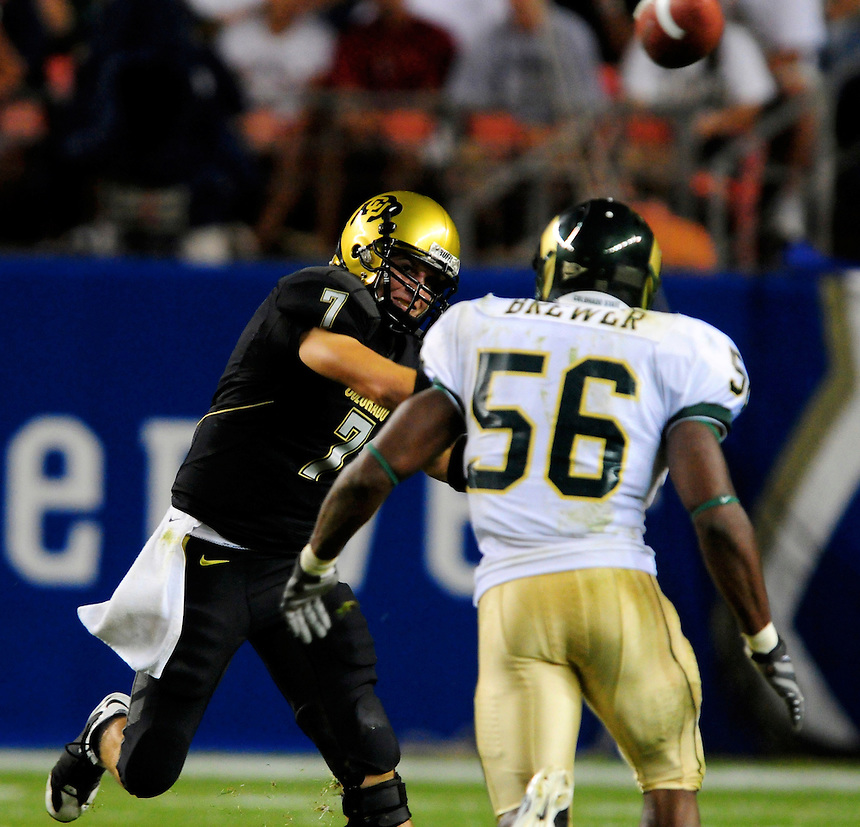 31 Aug 2008: Colorado quarterback Cody Hawkins passes under pressure from Colorado State linebacker Ricky Brewer. The Colorado Buffaloes defeated the Colorado State Rams 38-17 at Invesco Field at Mile High in Denver, Colorado. FOR EDITORIAL USE ONLY