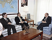 United States Secretary of Defense Dick Cheney hosted an Honor Arrival Cordon at the River Entrance of the Pentagon in Washington, DC on February 22, 1991 for Foreign Minister Kurtcebe Alptemocin of Turkey.  Seated in the Secretary's office is from left to right: Mr. Nuzaet Kandemir, Ambassador to the United States from the Republic of Turkey; Minister Alptemocin, and Secretary Cheney.<br /> Mandatory Credit: Helene C. Stikkel / Dod via CNP