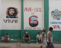 street scene in Havana, Cuba with graffiti of Che Guevara and other revolutionary icons in Havana Vieja (old Havana)