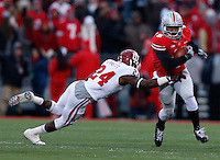 Ohio State Buckeyes quarterback Braxton Miller (5) slips a tackle by Indiana Hoosiers cornerback Tim Bennett (24) during Saturday's NCAA Division I football game at Ohio Stadium in Columbus on November 23, 2013. (Barbara J. Perenic/The Columbus Dispatch)