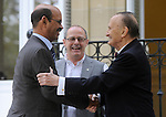 """Saharawi Salek Baba (L) is welcomed by Donostia´s mayor Juan Karlos Izagirre (Center) and Bixente Zaragueta (R) during the 2013 International Peace Conference """"Building peace starting at local level"""" to promote a resolution in the Basque Country on October 10, 2013, in the Basque city of Donostia-San Sebastian. (Ander Gillenea / Bostok Photo)"""