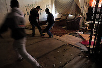 Young boys play football inside a devastated apartment block in the Gipsy ghetto of Chanov on outskirts of Most, Czech Republic, 26 March 2008.